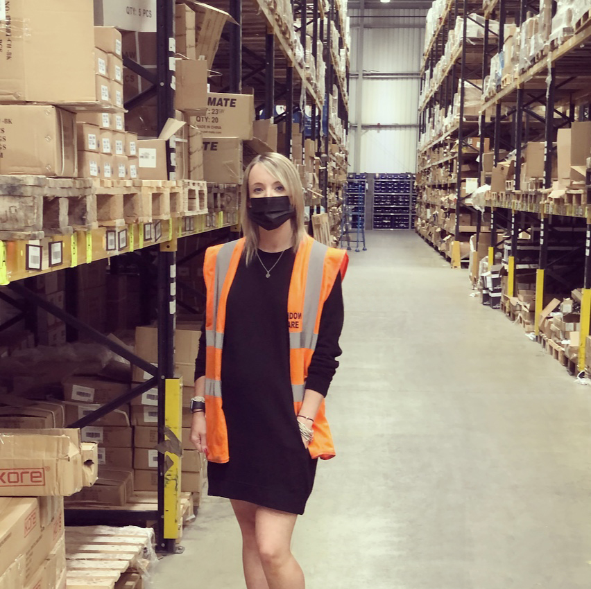 Laura in the warehouse
